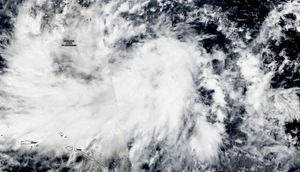 NASA sees Tropical Depression Man-yi, warnings triggered