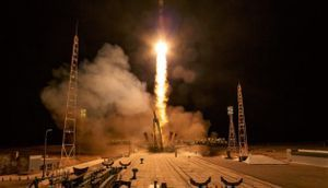 Months after aborted flight, U.S.-Russian crew makes smooth trip to space station